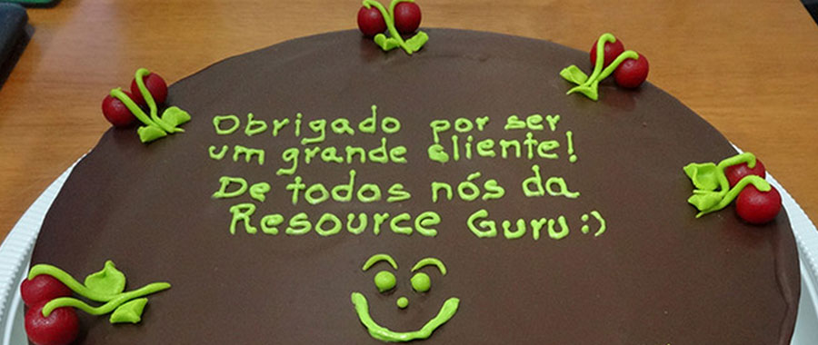 Chocolate cake, with a message written in green icing across the top