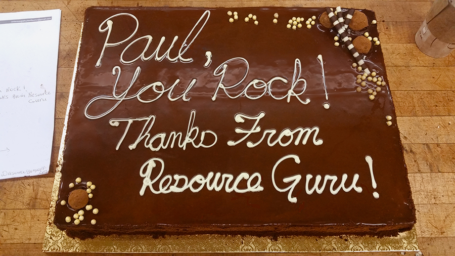 """Chocolate cake with message written in icing: """"Paul, you rock! Thanks from Resource Guru"""""""