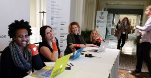 A few of the volunteers posing at the registration desk at the DPM Summit 2015
