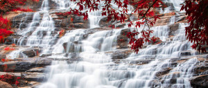Waterfall over stepped rocks.